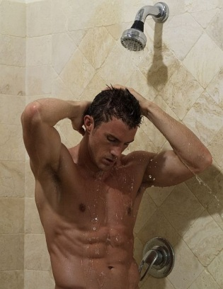 A young man having a shower